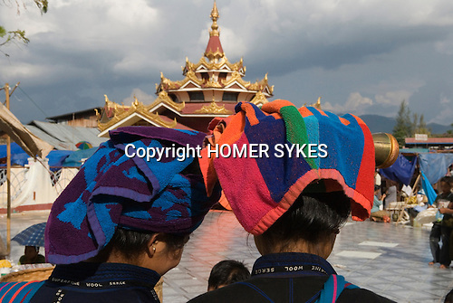 Two young Pa-O Pa Oh  girls with fashionable towel turbans at the annual festival at Phaung Daw Oo temple, where once a year monks attend from the area and receive new robes , money and food. Lake Inle. Myanmar (Burma.) 2006