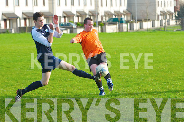 St Brendan's Park's Graham O'Sullivan and Atletico Ardfert's Trevor Wallace.