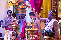 Hindu Priest Performing Ritual during Navarathri Celebrations, Sri Maha Mariamman Temple,  George Town, Penang, Malaysia.