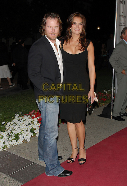 CHRIS HENCHY & BROOKE SHIELDS.The FX Season 4 Premiere Screening of Nip/Tuck held at The Paramount Studios in Hollywood, California, USA..August 25th, 2006.Ref: DVS.Nip Tuck full length black dress husband wife married jeans denim.www.capitalpictures.com.sales@capitalpictures.com.©Debbie VanStory/Capital Pictures