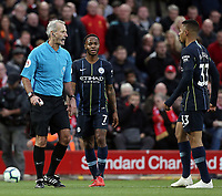 Referee Martin Atkinson has words with Manchester City's Gabriel Jesus as Raheem Sterling looks on ahead of a Liverpool free-kick<br /> <br /> Photographer Rich Linley/CameraSport<br /> <br /> The Premier League - Liverpool v Manchester City - Sunday 7th October 2018 - Anfield - Liverpool<br /> <br /> World Copyright &copy; 2018 CameraSport. All rights reserved. 43 Linden Ave. Countesthorpe. Leicester. England. LE8 5PG - Tel: +44 (0) 116 277 4147 - admin@camerasport.com - www.camerasport.com