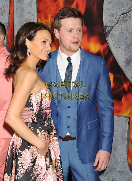 HOLLYWOOD, CA - MAY 26: Actress Carla Gugino (L) and actor Hugo Johnstone-Burt arrive at the 'San Andreas' - Los Angeles Premiere at TCL Chinese Theatre IMAX on May 26, 2015 in Hollywood, California.<br /> CAP/ROT/TM<br /> &copy;TM/ROT/Capital Pictures