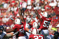 14 October 2006: Pannel Egboh, Pannel Egboh and Michael Okwo attempt to block a kick during Stanford's 20-7 loss to Arizona during Homecoming at Stanford Stadium in Stanford, CA.