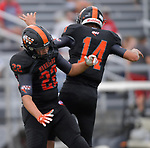 Wesclin running back Alex Peterson (left) and quarterback Devon Kahrhoff jump to celebrate Peterson's touchdown catch from Kahrhoff in the end zone. Wesclin defeated Dupo 34-30 on Saturday August 31, 2019 in a game that was stopped Friday night at halftime due to storms. <br /> Tim Vizer/Special to STLhighschoolsports.com