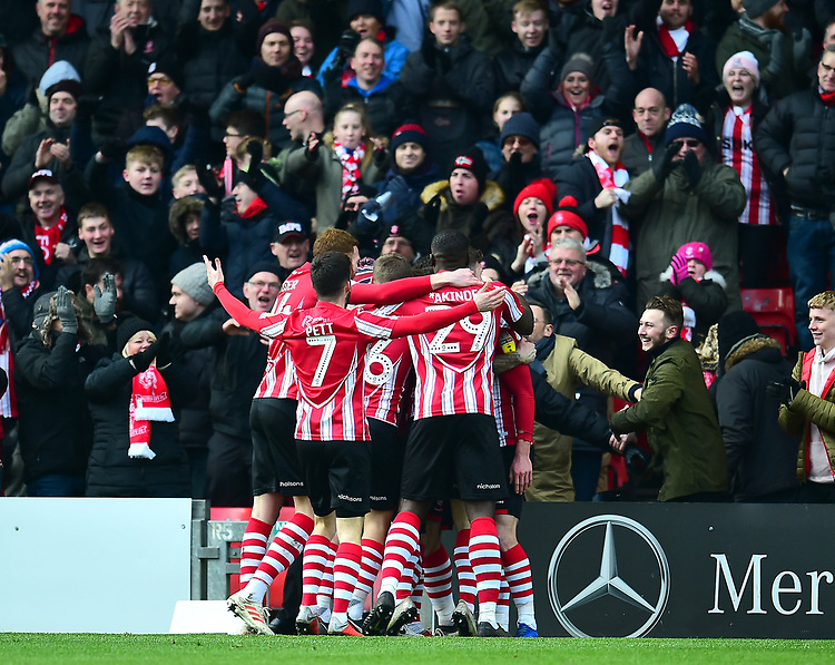 Lincoln City's Harry Toffolo celebrates scoring the opening goalwith team-mates<br /> <br /> Photographer Andrew Vaughan/CameraSport<br /> <br /> The EFL Sky Bet League Two - Lincoln City v Grimsby Town - Saturday 19 January 2019 - Sincil Bank - Lincoln<br /> <br /> World Copyright © 2019 CameraSport. All rights reserved. 43 Linden Ave. Countesthorpe. Leicester. England. LE8 5PG - Tel: +44 (0) 116 277 4147 - admin@camerasport.com - www.camerasport.com