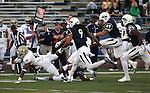 Nevada defenders Matthew Lyons (9) Jordan Dobrich (49) and Bryan Lane Jr. pursue UC Davis running back Joshua Kelley (41) during the first half of an NCAA college football game in Reno, Nev. on Thursday, Sept. 3, 2015. (AP/Cathleen Allison)
