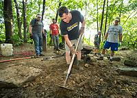 NWA Democrat-Gazette/BEN GOFF @NWABENGOFF<br /> John Sage of Fayetteville and other volunteers with Ozarks Off Road Cyclists add rock armoring Saturday, July 6, 2019, at the intersection of Last Call and Terrapin Station at Kessler Mountain Regional Park in Fayetteville. Volunteers used 11 tons of stone to shore up the often muddy and erosion-damaged section of the trail and recently completed similar projects on other trails at the park. The Ozark Off Road Cyclists, the local chapter of the International Mountain Bicycling Association, are raising funds through their Kessler Campaign to fund further improvements and future trails at the park.