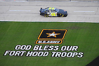 Nov. 8, 2009; Fort Worth, TX, USA; NASCAR Sprint Cup Series driver Jimmie Johnson passes a tribute to the soldiers killed at Fort Hood during the Dickies 500 at the Texas Motor Speedway. Mandatory Credit: Mark J. Rebilas-