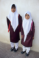 Batinah Coast, Oman, Arabian Peninsula, Middle East - Two Omani schoolgirls of Baluchi origin.