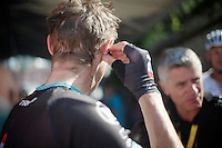 Jens Voigt (DEU) getting his earpiece out after the stage<br /> <br /> Tour de France 2013<br /> stage 16: Vaison-la-Romaine to Gap, 168km
