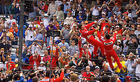 "87th Indianapolis 500, Indianapolis Motor Speedway, Speedway, Indiana, USA  25 May,2003.Winner Gil de Ferran celebrates ""Helio-style"" with his teamate..World Copyright©F.Peirce Williams 2003 .ref: Digital Image Only..F. Peirce Williams .photography.P.O.Box 455 Eaton, OH 45320.p: 317.358.7326  e: fpwp@mac.com.."