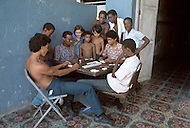 June, 1977. Havana, Cuba. Eighteen years after the Cuban Revolution the first U.S. tourists were permitted to visit Havana. Young Cubans pass the time playing cards and dominoes.