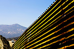 A US Border Patrol Agent patrols the US-Mexico border fence near Tecate, Mexico on Wednesday, April 12, 2006.<br />