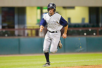 Andrew Garcia #6 of the Charlotte Knights scores a run in the top of the 11th inning against the Pawtucket Red Sox at McCoy Stadium on June 14, 2011 in Pawtucket, Rhode Island.  The Knights defeated the Red Sox 4-2 in 11 innings.    Photo by Brian Westerholt / Four Seam Images