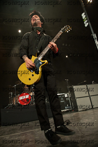 GREEN DAY - vocalist guitarist Billie Joe Armstrong - performing live at an intimate club gig to kickoff their 2013 Tour  at The Fox Theater in Pomona, California, USA - March 10, 2013.  Photo credit: Kevin Estrada / Iconicpix