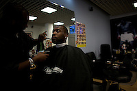 It's a busy day at Zeriff's barber shop in Hyde Park, Chicago where Senator Barack Obama, the 2008 democratic presidential candidate often has his hair cut when he is in Chicago..the Image was taken on Tuesday August 5 2008 in Chicago, Illinois, United States.