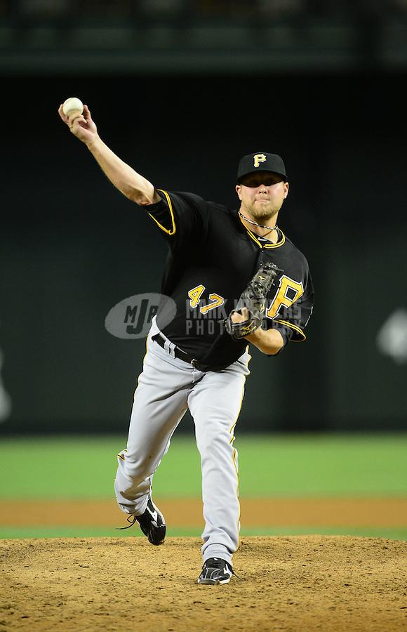 Apr. 17, 2012; Phoenix, AZ, USA; Pittsburgh Pirates pitcher Evan Meek throws during game against the Arizona Diamondbacks at Chase Field. Mandatory Credit: Mark J. Rebilas-
