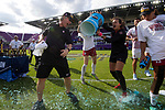 ORLANDO, FL - DECEMBER 03: Head Coach Paul Ratcliffe of Stanford University gets a powerade bath from goalie Alison Jahansouz #1after their victory over UCLA during the Division I Women's Soccer Championship held at Orlando City SC Stadium on December 3, 2017 in Orlando, Florida. Stanford defeated UCLA 3-2 for the national title. (Photo by Jamie Schwaberow/NCAA Photos via Getty Images)