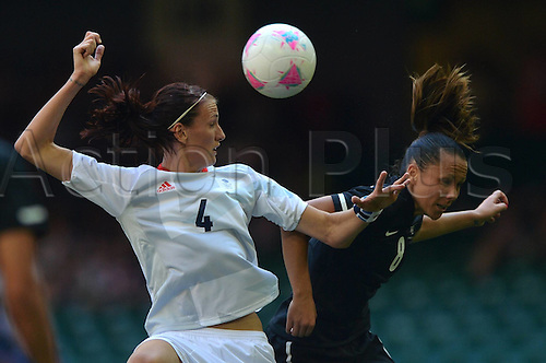 25.07.2012. Cardiff, Wales.  Jill Scott of Great Britain and Hayley Moor Wood of New Zealand vie to Head The Ball during The Preliminary Round Group E Match of Womens Football in Cardiff Wales. Great Britain Won The Match 1 0