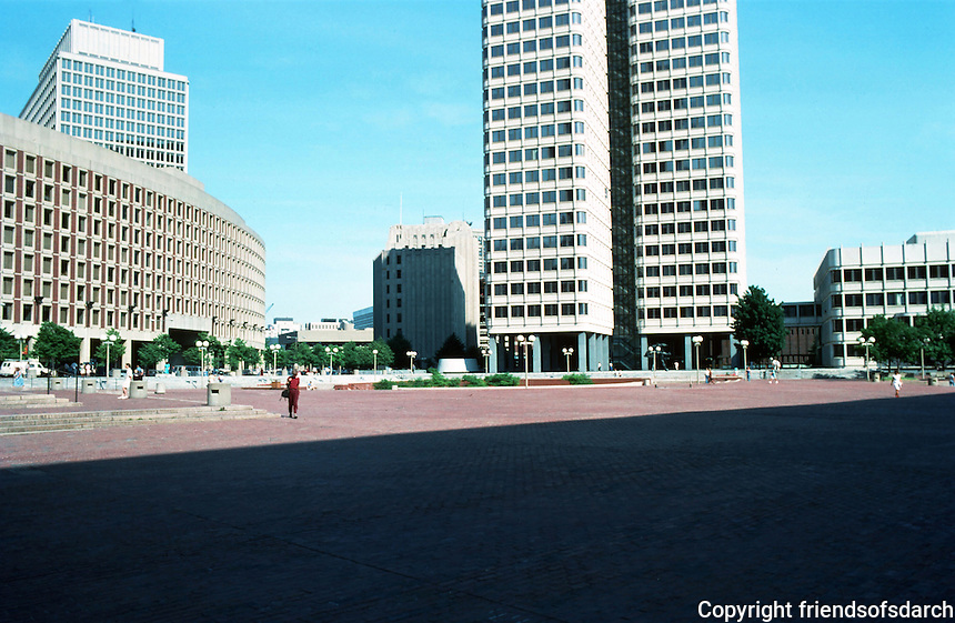 """Boston:   2.  City Hall Plaza--The curving facade visible here and in #1 is """"One Center Plaza"""", and across Cambridge St.  It is part of Government Complex, a modern 9 story building of brick and concrete designed byWelton Becket in 1967. It is not part of I.M.Pei's scheme.  Photo '88."""