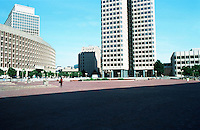 "Boston:   2.  City Hall Plaza--The curving facade visible here and in #1 is ""One Center Plaza"", and across Cambridge St.  It is part of Government Complex, a modern 9 story building of brick and concrete designed byWelton Becket in 1967. It is not part of I.M.Pei's scheme.  Photo '88."