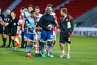 Adebayo Akinfenwa of Wycombe Wanderers (centre) plays peace maker at the final whistle in the Sky Bet League 2 match between Doncaster Rovers and Wycombe Wanderers at the Keepmoat Stadium, Doncaster, England on 29 October 2016. Photo by David Horn.