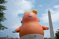 "Members of the protest group Code Pink set up the ""Baby Trump"" blimp in Washington D.C., U.S. on July 4, 2019, to protest United States President Donald J. Trump's Salute to America speech.  The group believes the president's participation in 4th of July celebrations is politicizing a non-political holiday. Photo Credit: Stefani Reynolds/CNP/AdMedia"