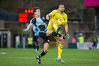 Liam Sercombe of Oxford United and Luke O'Nien of Wycombe Wanderers during the Sky Bet League 2 match between Wycombe Wanderers and Oxford United at Adams Park, High Wycombe, England on 19 December 2015. Photo by Andy Rowland.