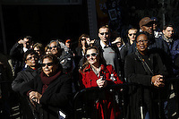 NEW YORK - OCT 29: Passersby watch a press conference. Olympic athletes participate in 100 Days to Sochi, a promotional event for the US Olympic Team, on Tuesday, October 29, 2013 in New York City. (Photo by Landon Nordeman)