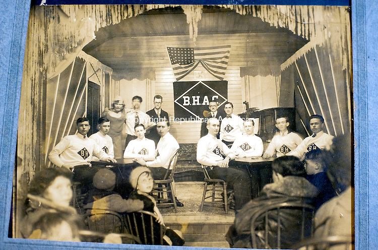 WATERBURY,  CT-111716JS10- A photo from the 1920's is one of the many historical photos sitting on the table as members talk about the history, and future, of the Bucks Hill Community Center at the center on Bucks Hill Road in Waterbury. <br /> Jim Shannon Republican American