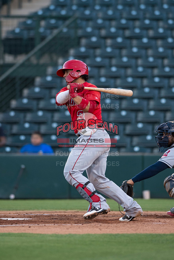 AZL Angels catcher Willian Mendoza (3) follows through on his swing during an Arizona League game against the AZL Indians 2 at Tempe Diablo Stadium on June 30, 2018 in Tempe, Arizona. The AZL Indians 2 defeated the AZL Angels by a score of 13-8. (Zachary Lucy/Four Seam Images)