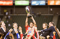 FC Dallas Captain Daniel Hernandez hoists the MLS Western Conference Chapionship trophy. FC Dallas defeated the LA Galaxy 3-0 to win the Western Division 2010 MLS Championship at Home Depot Center stadium in Carson, California on Sunday November 14, 2010.
