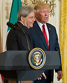 United States President Donald J. Trump, right, and Prime Minister Paolo Gentiloni of Italy, left, depart after conducting a joint press conference in the East Room of the White House in Washington, DC on Thursday, April 20, 2017.<br /> Credit: Ron Sachs / CNP