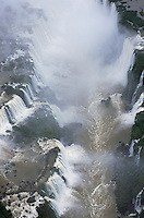 A spectacular aerial view of the Garganta del Diablo, or Devil's Throat, in the Iguazu Falls, giving an idea of how much spray the Falls throw off. The Falls consist of some 275 separate waterfalls - or, in the rainy season, 350 - and the distance from top to bottom is about 250 feet.