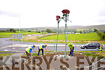 Neilus O'Shea, Janek Dierak and Tommy Laide of Designer Landscapes, Tralee installing the new Rose statue on the Tralee Bypass road on Wednesday.
