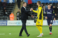 Graham Potter Manager of Swansea City and Kristoffer Nordfeldt of Swansea City at full time during the Sky Bet Championship match between Swansea City and Derby County at the Liberty Stadium in Swansea, Wales, UK. Wednesday 01 May 2019