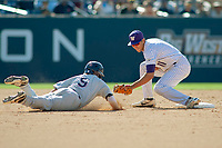 Cal State Fullerton Titans Hank LoForte (9) slides into second base and is tagged out by University of Washington Huskies AJ Graffanino (11) during the game at Goodwin Field on June 09, 2018 in Fullerton, California. The Cal State Fullerton Titans defeated the University of Washington Huskies 5-2. (Donn Parris/Four Seam Images)