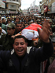 """Palestinians carry the body of Raed Zeiter, 38, during his funeral in the northern West Bank city of Nablus, on March 11, 2014, a day after he was shot dead by the Israeli military. The Jordanian-Palestinian judge was shot by Israeli troops at the Allenby Bridge border crossing between the West Bank and Jordan, after he allegedly tried to snatch a weapon and """"strangle"""" an Israeli soldier, a preliminary Israeli army investigation showed. Photo by Nedal Eshtayah"""