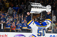 June 12, 2019: St. Louis Blues goaltender Jordan Binnington (50) hoists the Stanley Cup for fanes at game 7 of the NHL Stanley Cup Finals between the St Louis Blues and the Boston Bruins held at TD Garden, in Boston, Mass.  The Saint Louis Blues defeat the Boston Bruins 4-1 in game 7 to win the 2019 Stanley Cup Championship.  Eric Canha/CSM.