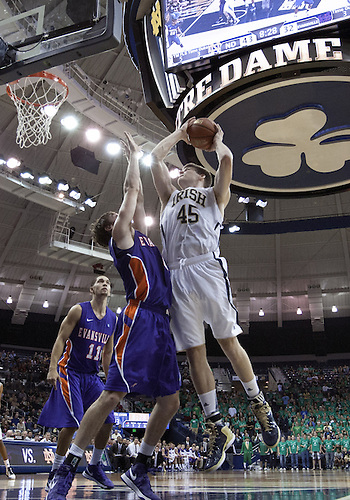 November 10, 2012:  Notre Dame forward Jack Cooley (45) goes up for a shot as Evansville forward Ryan Sawvell (0) defends during NCAA Basketball game action between the Notre Dame Fighting Irish and the Evansville Purple Aces at Purcell Pavilion at the Joyce Center in South Bend, Indiana.  Notre Dame defeated Evansville 58-49.