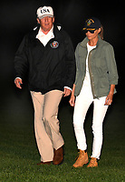 United States President Donald J. Trump and First Lady Melania Trump walk the South Lawn as they return to the White House after a day trip to Puerto Rico where he viewed and was briefed on the Hurricane Irma devastation, October 3, 2017, in Washington, DC.     <br /> <br /> CAP/MPI/CNP/RS<br /> &copy;RS/CNP/MPI/Capital Pictures