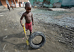 A boy plays with a tire in Batey Bombita, a community in the southwest of the Dominican Republic whose population is composed of Haitian immigrants and their descendents.
