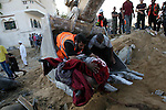 Palestinian rescue workers use an excavator to remove a dead body after what witnesses said was an Israeli air strike on the al-Najar family house in Khan Younis in the southern Gaza Strip July 26, 2014. A 12-hour humanitarian truce went into effect on Saturday after Israel and Palestinian militant groups in the Gaza Strip agreed to a U.N. request for a pause in fighting and efforts proceeded to secure a long-term ceasefire moved ahead.The Gaza Health Ministry said 18 members of a single family were killed by Israeli tank shelling in the southern Gaza Strip shortly before the truce took effect at 8 a.m. (6 a.m. British Time). An Israeli military spokeswoman said she was checking the report. An Israeli military spokeswoman said she was checking the report. A 12-hour humanitarian truce went into effect on Saturday after Israel and Palestinian militant groups in the Gaza Strip agreed to a U.N. request for a pause in fighting and efforts proceeded to secure a long-term ceasefire moved ahead. Photo by Eyad Al Baba