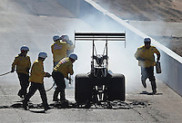Feb. 24, 2013; Chandler, AZ, USA; Safety safari crews tend to a fire on the car of NHRA top fuel dragster driver Clay Millican during the Arizona Nationals at Firebird International Raceway. Mandatory Credit: Mark J. Rebilas-