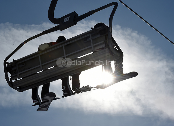 Athletes sitting on a lift in the Olympic Snowboard Phoenix Snow Park in Pyeongchang, South Korea, 07 January 2018. The Pyeongchang 2018 Winter Olympics take place between 09 and 25 February. Photo: Angelika Warmuth/dpa /MediaPunch ***FOR USA ONLY***