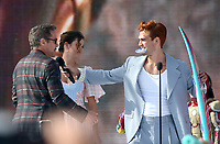 "Robert Downey Jr., Maia Mitchell and KJ Apa onstage at FOX's ""Teen Choice 2019"" at the Hermosa Beach Pier Plaza on August 11, 2019 in Hermosa Beach, California. (Photo by Frank Micelotta/Fox/PictureGroup)"