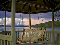 Sunrise with swing in gazebo. St. John, Virgin Islands.