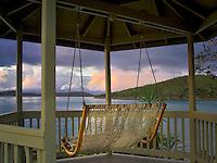Sunrise with swing in gazebo. St. John, Virgin Islands.