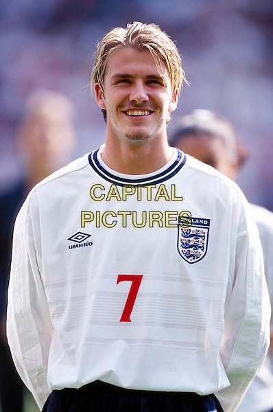 DAVID BECKHAM.england, smiling, football, kit strip, footballer.Ref: 8802/0509i.www.capitalpictures.com.sales@capitalpictures.com.© Capital Pictures