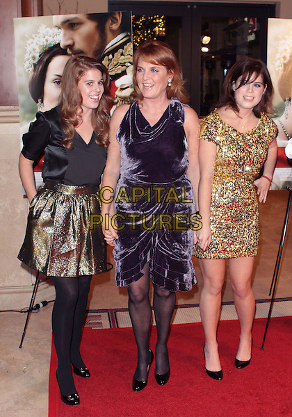 "PRINCESS BEATRICE, SARAH FERGUSON, Duchess of York & PRINCESS EUGENIE .""The Young Victoria"" US Premiere held The Pacific Theatres The Grove, Los Angeles, California, USA, .3rd December 2009..royal fergie family mother daughters sisters full length purple velvet dress black tights shoes gold sequined sequin skirt black top patent layered tiered holding hands .CAP/ADM/TC.©T. Conrad/AdMedia/Capital Pictures."